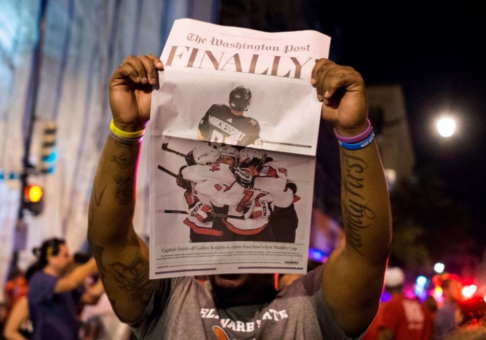 man-holds-up-a-copy-of-the-washington-post-as-washington-capitals-fan-picture-id969523630-story-large-728a08f0-f211-43b6-8ffa-9e15615e65f6